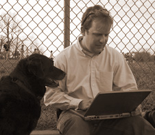 Trainer with computer and Dog